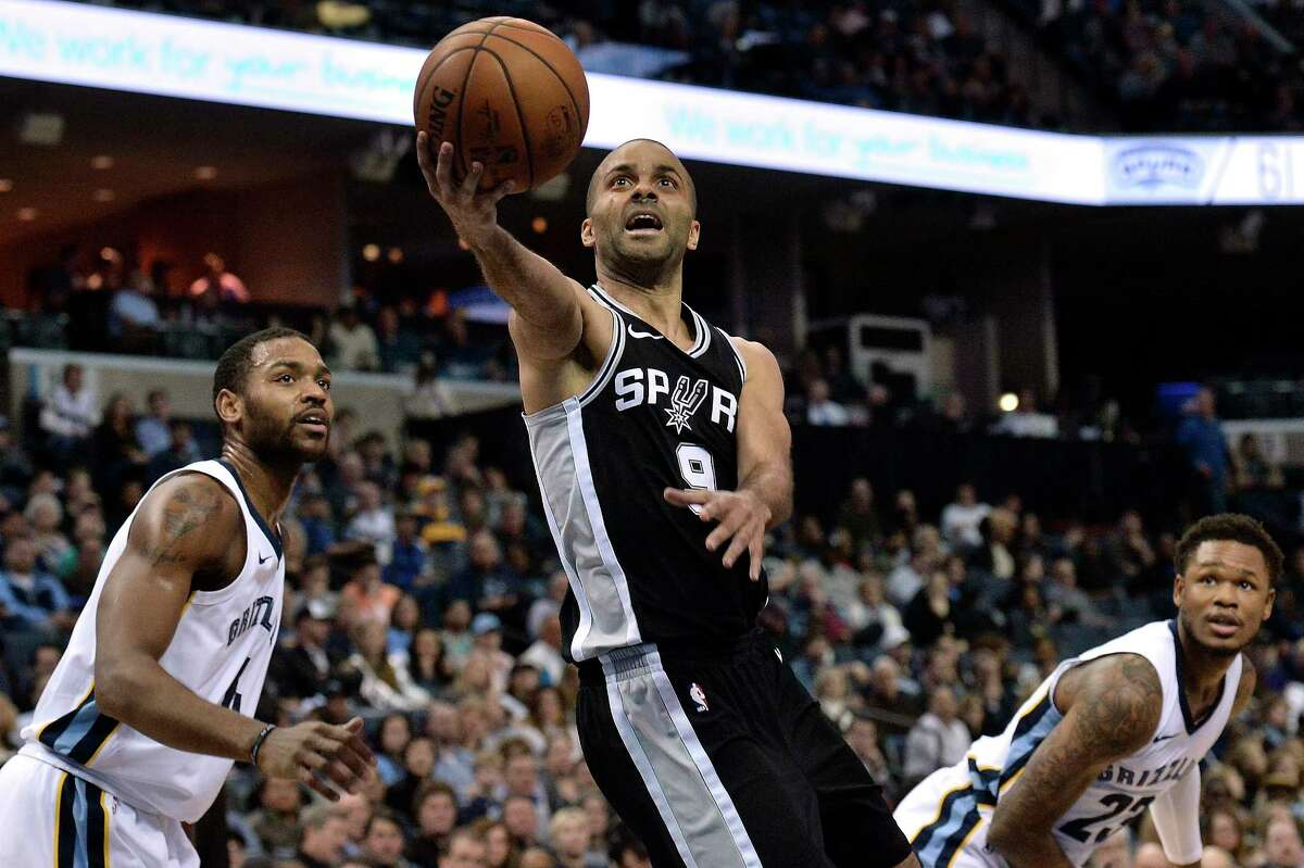 San Antonio Spurs guard Tony Parker (9) shoots between Memphis Grizzlies forward Myke Henry (4) and guard Ben McLemore (23) during the second half of an NBA basketball game Wednesday, Jan. 24, 2018, in Memphis, Tenn. (AP Photo/Brandon Dill)
