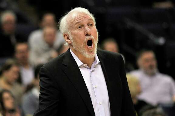 San Antonio Spurs coach Gregg Popovich calls to players during the first half of an NBA basketball game against the Memphis Grizzlies on Friday, Dec. 1, 2017, in Memphis, Tenn. (AP Photo/Brandon Dill)