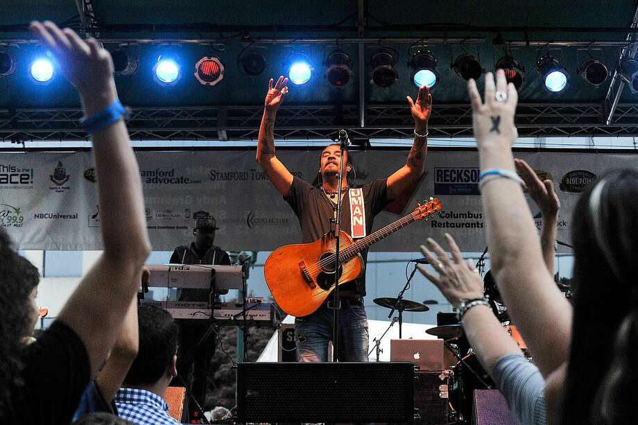 Michael Franti and Spearhead perfroms on stage during Alive@Five in Columbus Park in Stamford, Conn., on Thursday, July 9, 2015. The concerts begin at 5 p.m. and run for six Thursdays, July 9 - August 13. Hearst Connecticut Media is a sponsor of the event. Photo: Jason Rearick, Hearst Connecticut Media