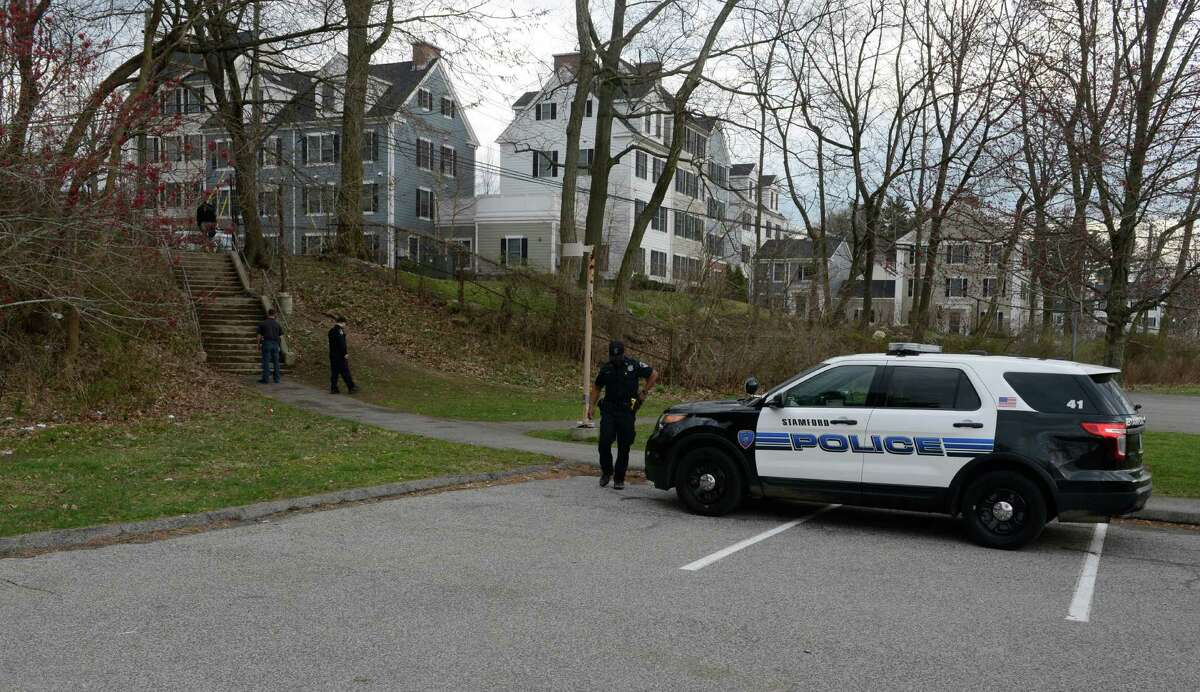 Stamford Police investigate the scene of a shooting near stairs leading from Progress Drive onto the school grounds of Westover Elementary School in Stamford on March 25, 2016.
