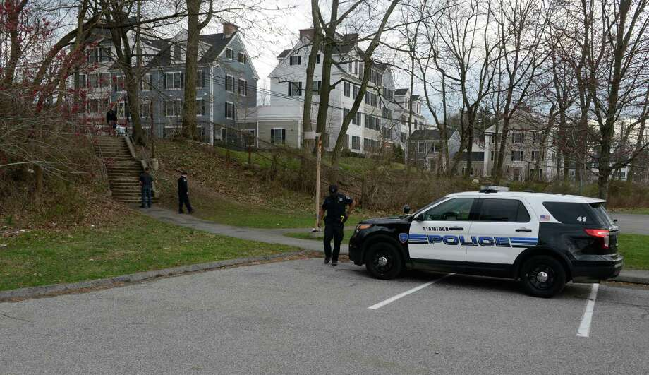 Stamford Police investigate the scene of a shooting near stairs leading from Progress Drive onto the school grounds of  Westover Elementary School  in Stamford on March 25, 2016. Photo: Matthew Brown / Hearst Connecticut Media / Stamford Advocate