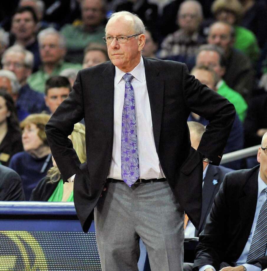 Roy Williams, left, is weathering an NCAA investigation into an academic scandal involving North Carolina athletics. Syracuse's Jim Boeheim sat out the first nine games this season for improprieties by his program. Photo: Joe Raymond, FRE / FR25092 AP