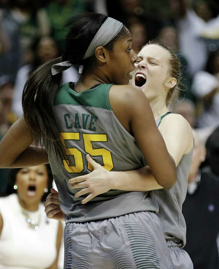 Baylor guard Kristy Wallace, right, celebrates a scoring rally with forward Khadijiah Cave, left, during the second half of a regional final of the women's NCAA Tournament against Oregon State Monday, March 28, 2016, in Dallas. Photo: Brandon Wade, AP / FR168019 AP