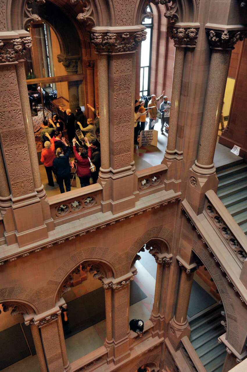 Supporters of a $15 minimum wage hold a vigil outside the Senate lobby at the Capitol on Monday, March 28, 2016, in Albany, N.Y. (Paul Buckowski / Times Union)
