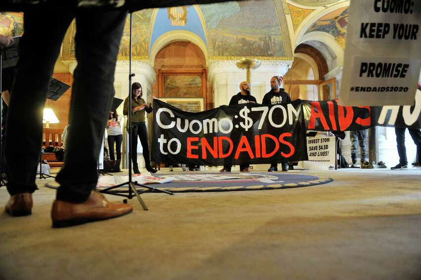 AIDS activists hold a protest in the War Room at the Capitol on Monday, March 28, 2016, in Albany, N.Y. The activists are calling for more funding in the State budget for AIDS. (Paul Buckowski / Times Union)
