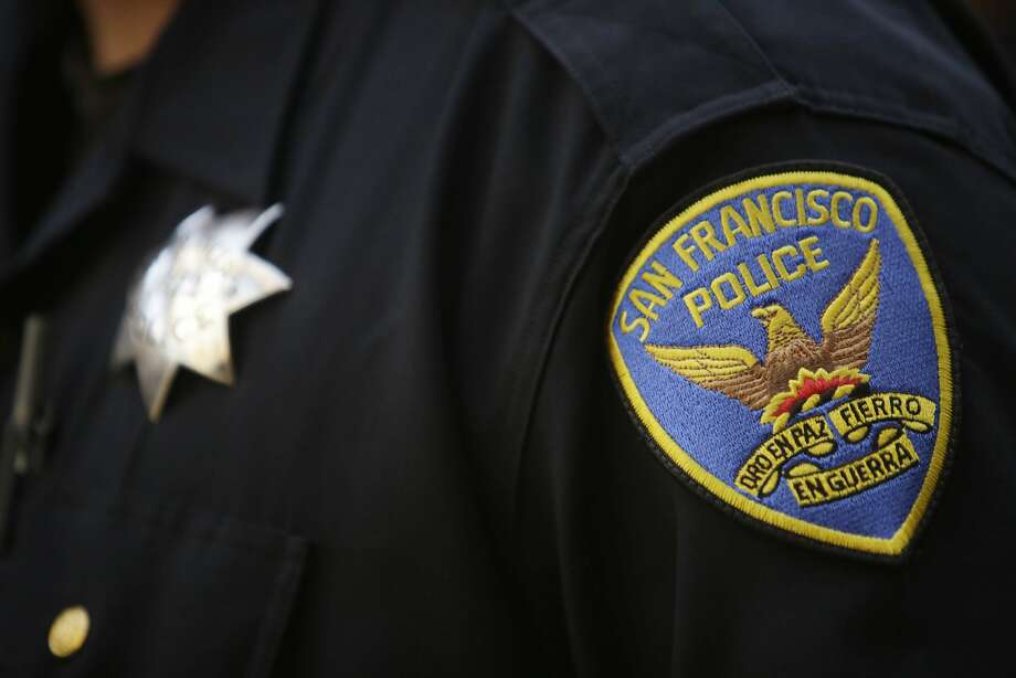 A San Francisco Police patch is seen on the uniform of an officer as he stands with members of the board of directors, members of the association and members of the community while Martin Halloran (not shown), San Francisco Police Officers Association president, speaks during a press conference at the San Francisco Police Officers Association headquarters on Wednesday, December 16, 2015 in San Francisco, Calif. Photo: Lea Suzuki / The Chronicle