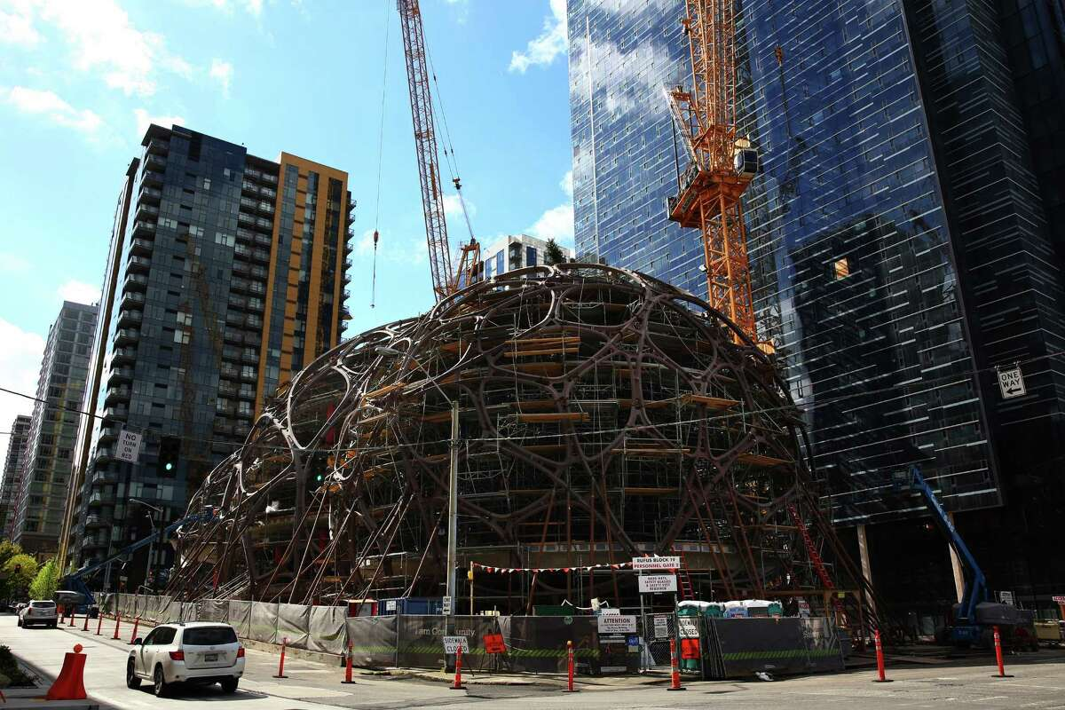 Work continues on the Amazon sphere-structures downtown, Monday, Mar. 28, 2016.