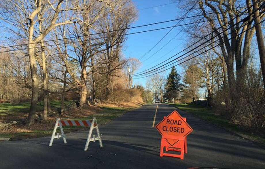 Downed trees, branches and wires forced the closure of Currituck Road in Newtown on Tuesday, March 29, 2016. Photo: Brian Koonz /Hearst Connecticut Media