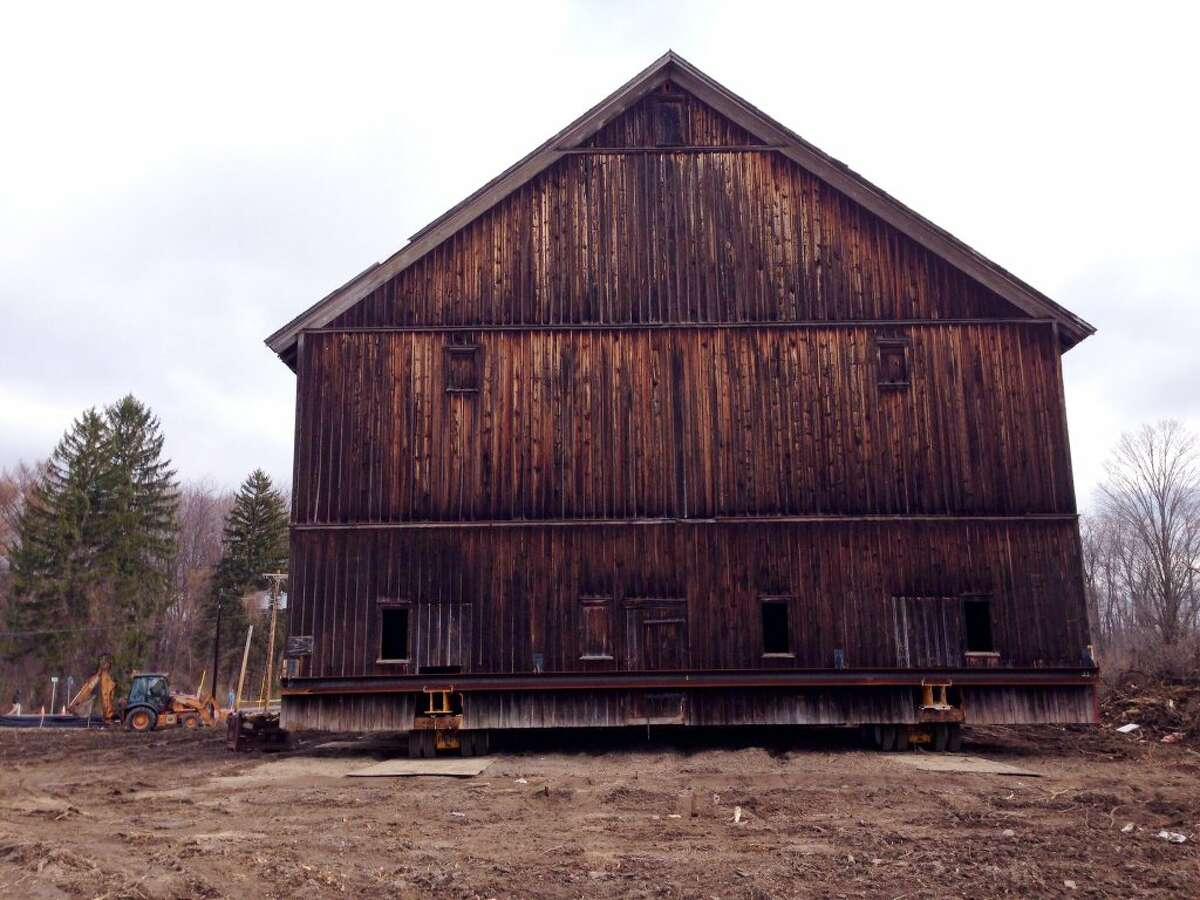 The Hilton Barn at LeVie Farm on Route 85A was lifted onto a trailer bed for the 75 feet to the foundation built on nearby Maple Road. The barn was a risk for demolition at its current locations which is being eye for a housing development. The move will cost approximately $150,000. The town of New Scotland contributed $25,000 for the move and Albany County contributed $50,000. (Paul Buckowski / Times Union)