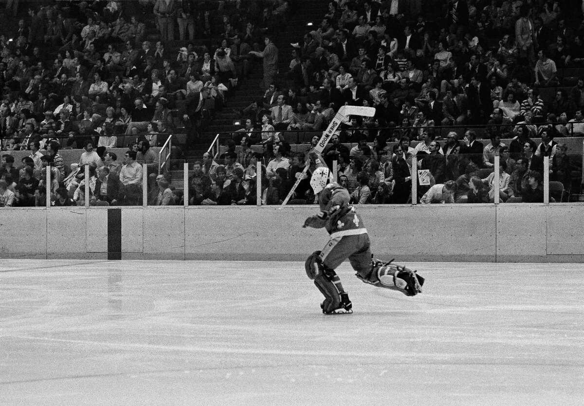 Goalie Richard Brodeur of the Quebec Nordiques, skates down the ice with his stick raised triumphantly after teammate Paul Baxter scored the winning goal against the New England Whalers with 1:50 gone in overtime during the first World Hockey Association playoff game in Hartford, Conn., April 15, 1977. The win gave Quebec a 3-0 lead in the best-of-seven series.