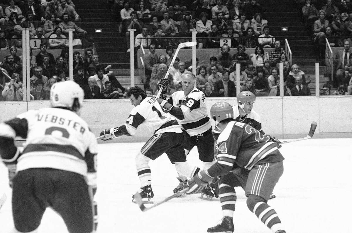 Gordie Howe (9 in white) pushes his way toward the puck in the second period of the New England Whalers-Winnipeg Jets World Hockey Association game in Hartford on Friday, Nov. 19, 1977. Howe, who joined the Whalers this season, was frustrated for the third consecutive game in his bid for his 1,000th career goal in the Friday game.