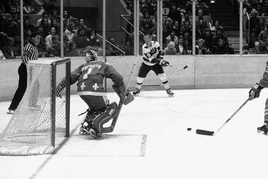 Gordie Howe of the New England Whalers gets set to shoot the puck as Winnipeg Jets goalie Joe Daly sets up during the second period of the Jets-Whalers World Hockey Association game in Hartford, Connecticut, Friday, Nov. 19, 1977. Howe, who needs one goal to score 1,000 career goals had his shot blocked. Howe had several opportunities to score but was blocked each time. Coming in the Daly's aid is Larry Hornung of Winnipeg. Photo: Bob Child, AP Photo / AP1977