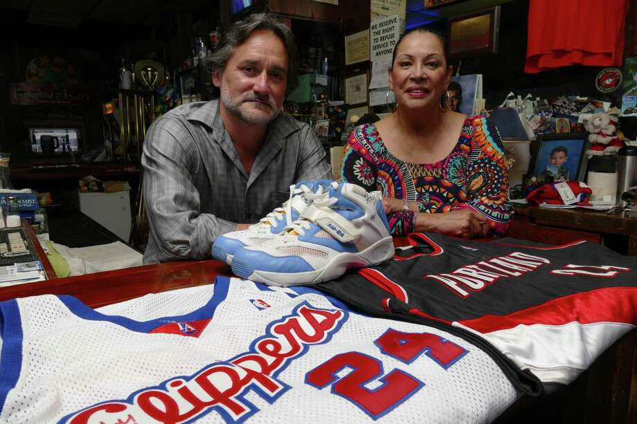 Kathy Chavez and Sal Guerrero, who operate My Brother's Bar, are longtime friends of Spurs guard Andre Miller, who they met when he came into their bar with the other members of the University of Utah basketball team after they lost to Kentucky in the NCAA championship game on March 30, 1998. They keep souvenirs debt by Miller in the bar. Photo: Billy Calzada /San Antonio Express-News / San Antonio Express-News