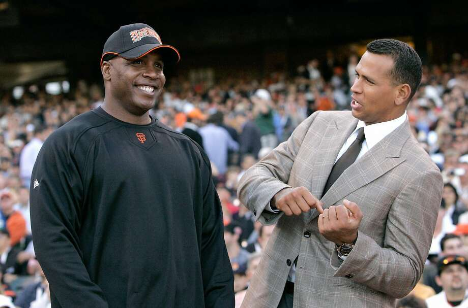 In this 2007 file photo, Alex Rodriguez talks with Barry Bonds during the All-Star Home Run Baseball Derby in San Francisco. Photo: Jeff Chiu, AP