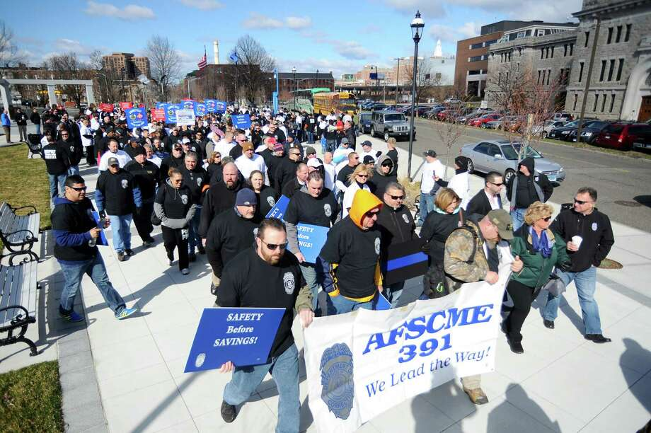 Hundreds of unionized state employees joined together outside of the Capitol to underscore how potential layoffs will affect Connecticut's quality of life on Tuesday, March 29, 2016 in Hartford, Conn. Photo: Michael Cummo / Hearst Connecticut Media / Stamford Advocate