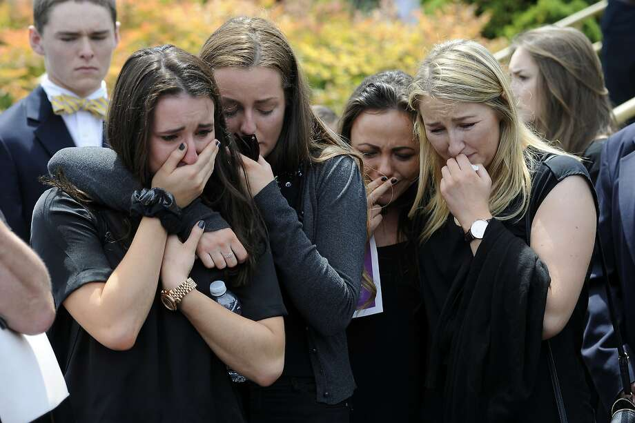 FILE- In this Saturday, June 20, 2015 file photo, mourners cry as the caskets of cousins Olivia Burke, 21, and Ashley Donohoe, 22, are placed in hearses following services at St. Joseph Catholic Church in Cotati, Calif., Saturday, June 20, 2015. The two woman were among the several people killed when a balcony snapped off the fifth floor of a Berkeley apartment building during a birthday party. The seven Irish students who survived a balcony collapse remain hospitalized in varying states of recovery nearly a week later. (AP Photo/Michael Short, File) Photo: Michael Short, Associated Press