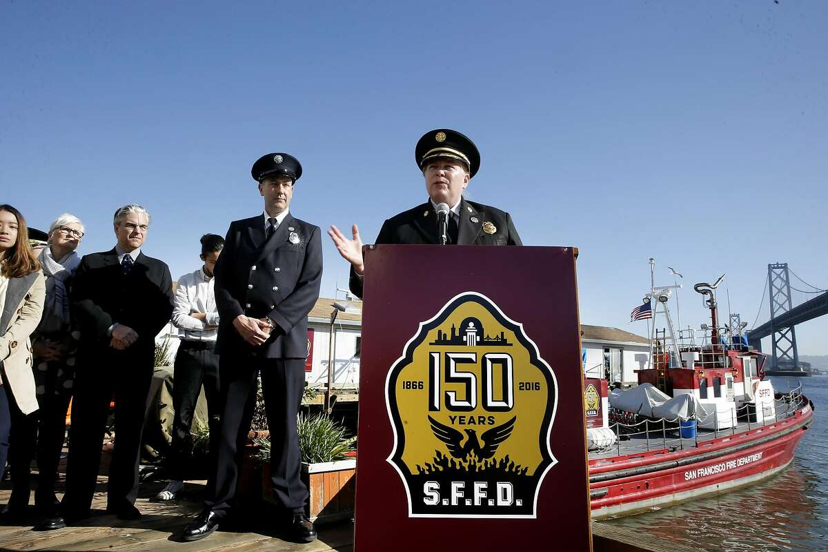 FILE-- San Francisco Fire Department Chief Joanne Hayes-White unveils their new logo to celebrate their 150th anniversary, during a ceremony at fire station 35 along the Embarcadero in San Francisco, California, on Tues. March 29, 2016. The project was possible through a collaboration with the students from the Academy of Art University of Graphic Design.