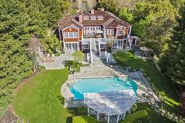 This aerial shot of 4045 Happy Valley Road in Lafayette shows off the shingled home's stylish architecture and lavish grounds.