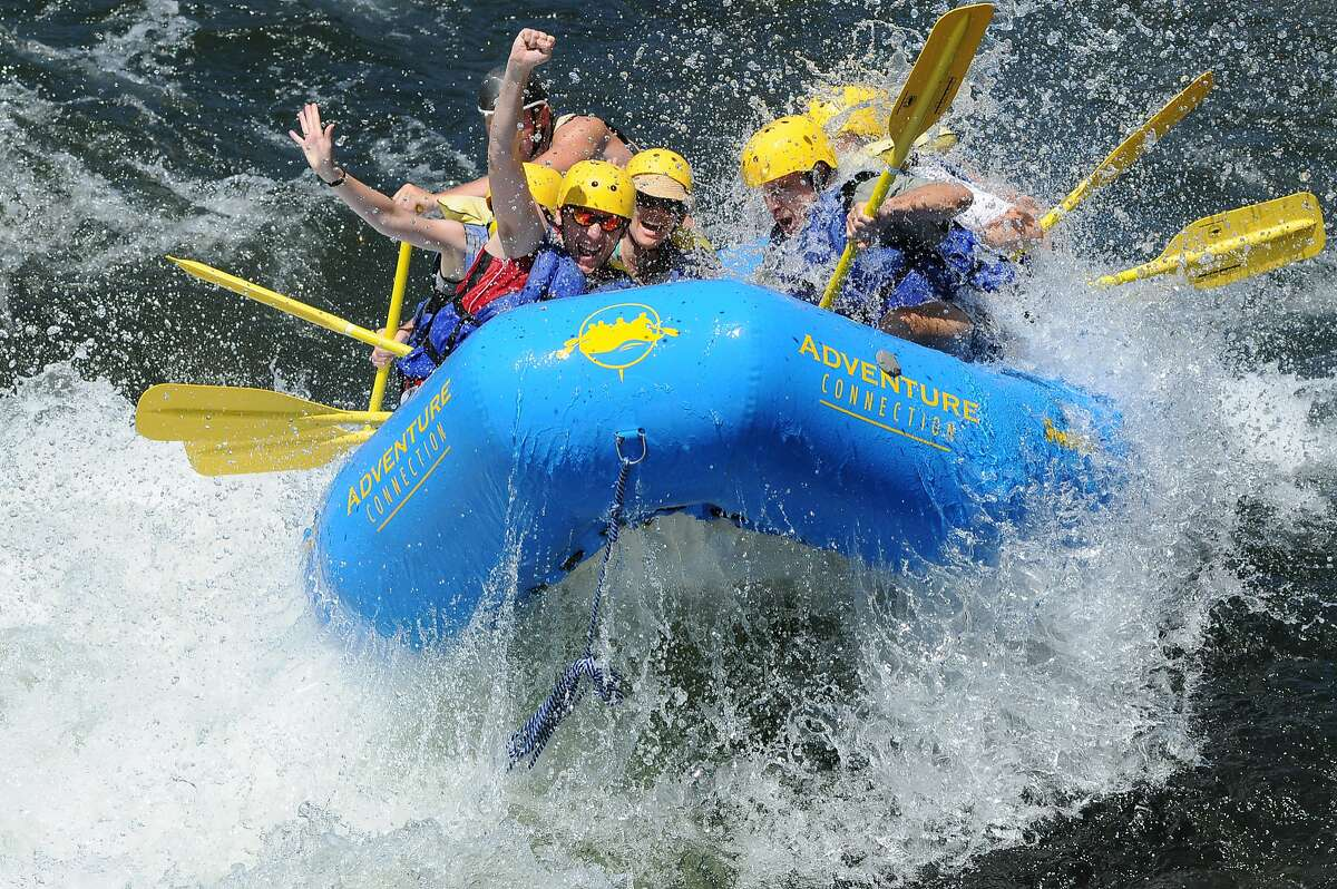 A guided rafting trip plunges through Satan's Cesspool on the South Fork American River in the foothills of the Sierra Nevada east of Sacramento. This year's snowpack in the high Sierra will mean plenty of water for rafting this coming year.