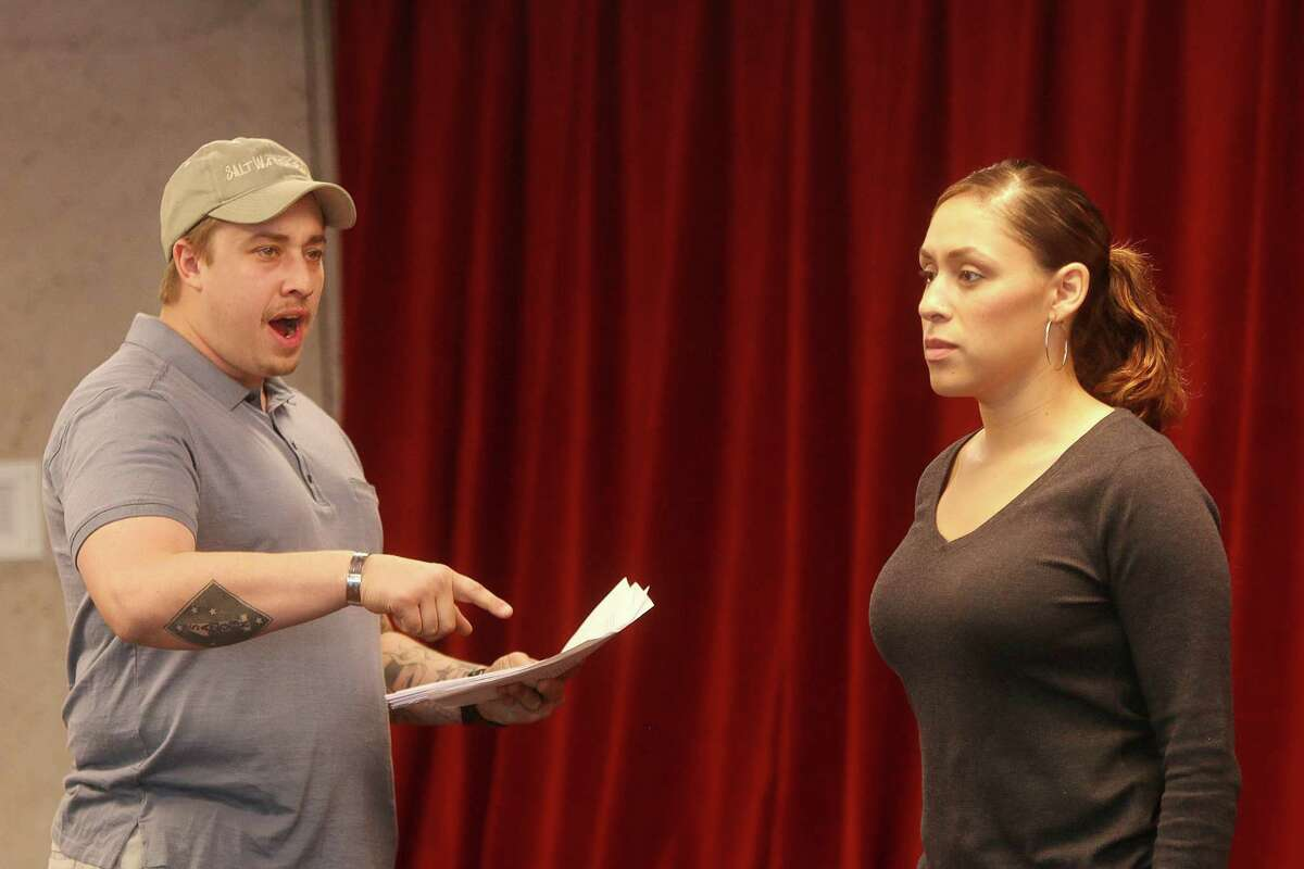Military veterans Phil McCulloch and T'Liza Kiel rehearse a scene from The Telling Project's show,