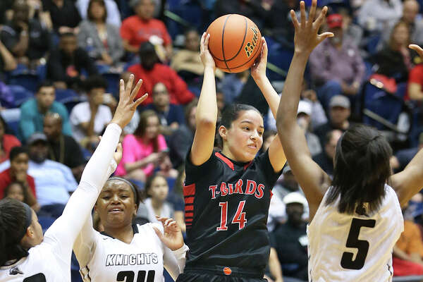 Thunderbird guard Amber Ramirez finds herself surrounded as Steele beats Wagner in the Region IV-6A championship girls basketball game at the UTSA Convocation Center on February 27, 2016.