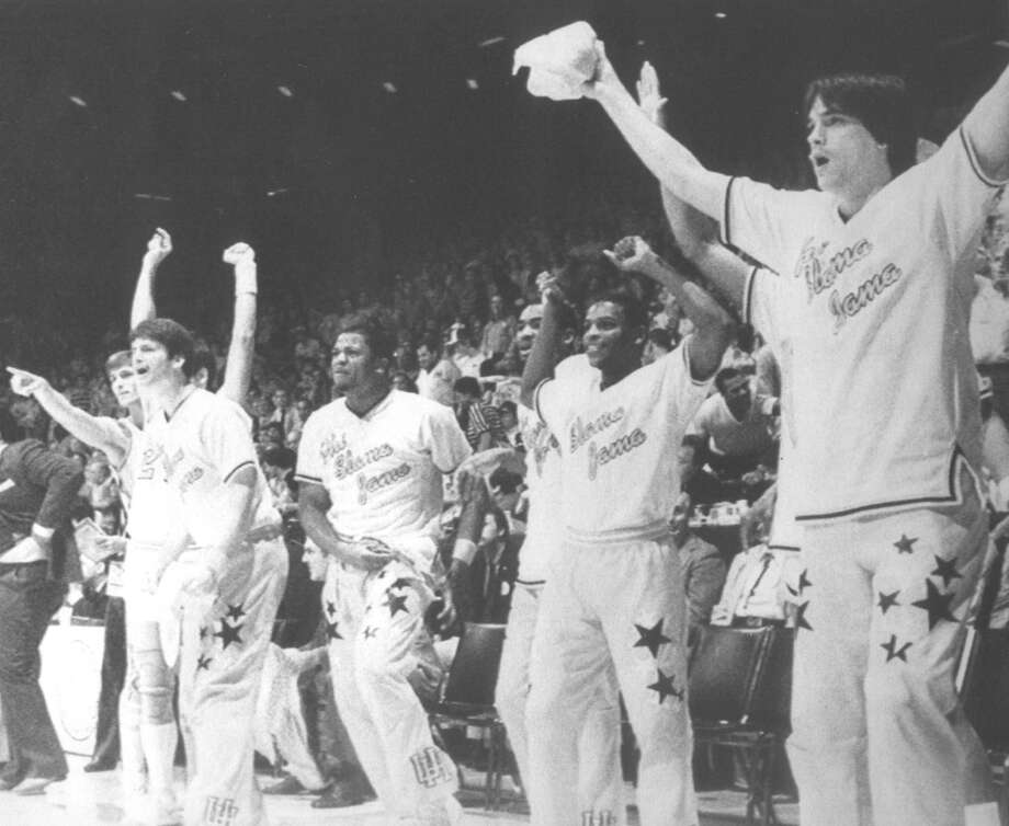 04/02/1983 - The Houston Cougar bench, in their Phi Slama Jama warmups, reacts to a slam dunk during action agiainst the Louisville Cardinals Saturday in the NCAA game played at the University of New Mexico Arena in Albuquerque. Associated Press Laser Photo Photo: Associated Press / AP Wirephoto