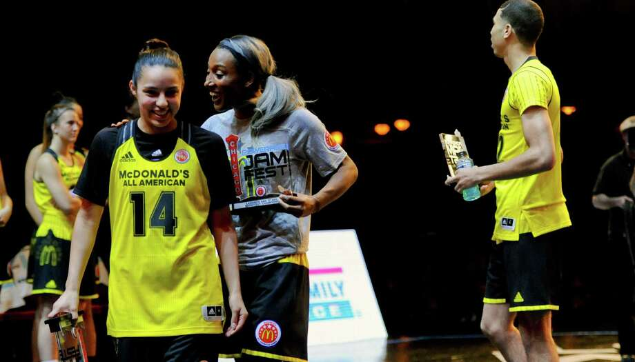 Wagner's Amber Ramirez (from left), former WNBA player Candice Wiggins and Jason Tatum of St. Louis walk off with trophies after winning the Legends and Stars Shootout at the McDonald's All-American Jam Fest on March 28, 2016, in Chicago. Photo: Matt Marton /Associated Press / FR170980 AP