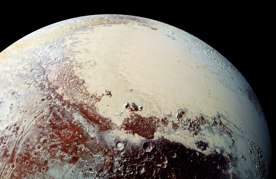 An undated photo taken by NASA's New Horizons spacecraft of the Tombaugh Regio, a large, white and smooth heart-shaped area of Pluto which is rich in nitrogen, carbon monoxide and methane ices. Researchers at NASA have analyzed data returned by the New Horizons probe, that describe an icy terrain as bizarre as any in science fiction. (Johns Hopkins Applied Physics Laboratory/NASA via The New York Times) --NO SALES; FOR EDITORIAL USE ONLY WITH STORY SLUGGED SCI PLUTO ICE  BY CHANG FOR MARCH 22, 2016. ALL OTHER USE PROHIBITED. ORG XMIT: XNYT112 Photo: JOHNS HOPKINS APPLIED PHYSICS LABORATORY/NASA / JOHNS HOPKINS APPLIED PHYSICS LABORATORY/NASA