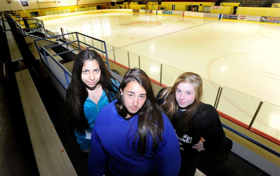 Hockey enthusiasts from left, Cassie Miolene, 12, Sarah Ehrloch, 15, and Maria Mossa, 14, at Terry Connors Ice Rink in Stamford, Conn., Monday, April 12, 2010.  They and 32 other Stamford girls want to form a coop high school ice hockey team for Stamford which, unlike many towns around that have high-school level girls hockey teams, does not have one. However, in a tight budget year, the Board of Education does not plan on funding one. Photo: Keelin Daly, ST / Stamford Advocate