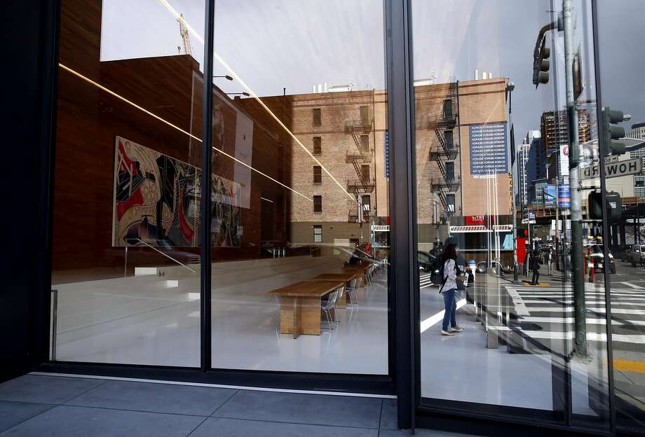 Brick buildings that neighbor the new tower at 222 Second St. are seen in the reflection of the glass partially enclosing the public space in the building in downtown San Francisco, California, on Monday, March 28, 2016. Photo: Connor Radnovich, The Chronicle