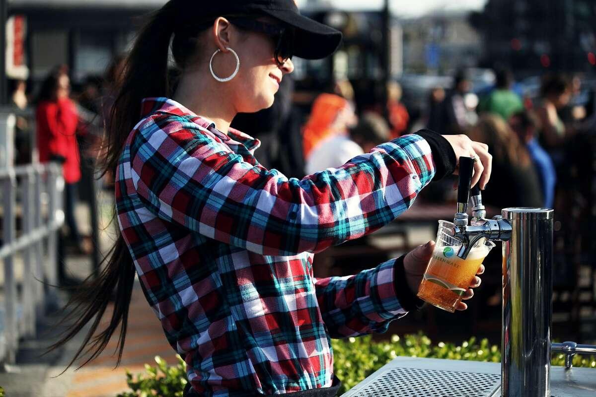 Megan Donovan serves beer at The Yard at Mission Rock next to AT&T Park in San Francisco, Calif., Friday April 3, 2015.