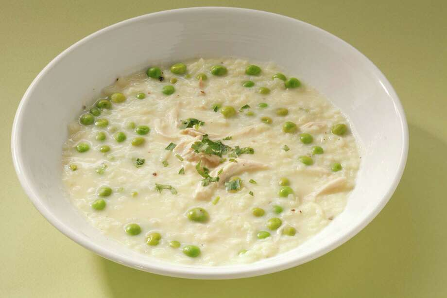 Avgolemono Soup with English Peas is a great way to use up leftover chicken, or you can buy a rotisserie chicken to shred. Photo: Craig Lee /Special To The San Francisco Chronicle / ONLINE_YES