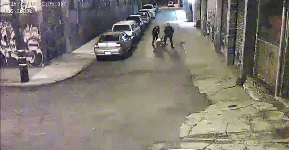 Two Alameda County Sheriff deputies are shown beating a man on Nov. 12, 2015 on a street in San Francisco's Mission District in a video screen grab provided by the San Francisco Public Defender's Office. Photo: San Francisco Public Defender's Office