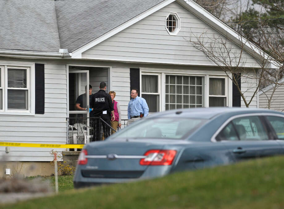Police investigate the scene of a fatal shooting last Friday on Governors Lane in Bethel. Photo: H John Voorhees III / Hearst Connecticut Media