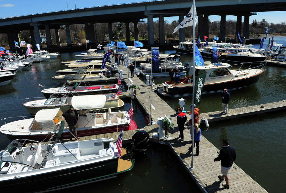 Area residents gather to check out some of the boats for sale at the annual Greenwich Boat Show at the Greenwich Water Club in Greenwich, on Apr. 11, 2015. Photo: Christian Abraham / Christian Abraham / Greenwich Time