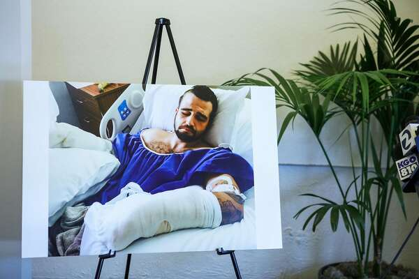 A poster of Stanislav Petrov, 29, in a hospital bed is shown  during a press conference, in Oakland, California, on Tuesday, March 29, 2016. Petrov was beaten in an alley on November 12, 2015 by Alameda County Sheriff deputies and his lawyers plan to file a federal civil rights lawsuit.