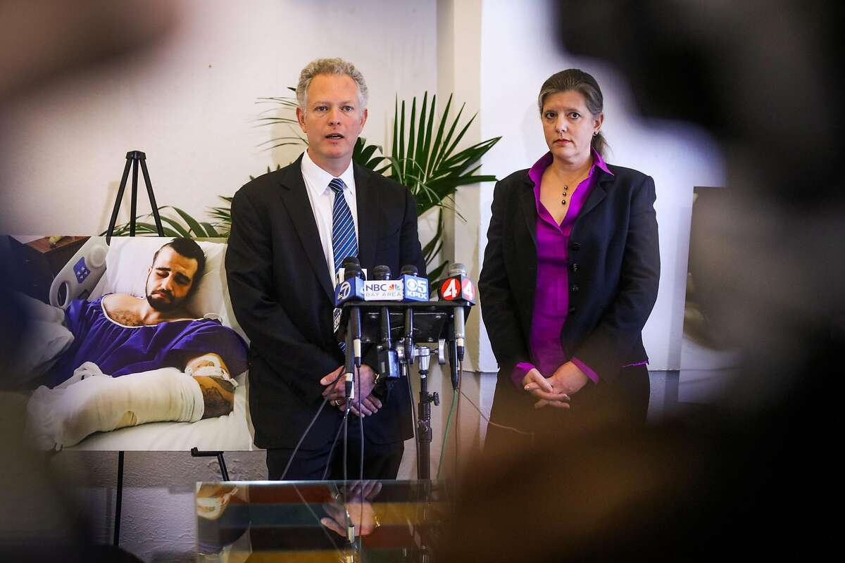 Lawyer Michael Haddad (left) discusses the disturbing police misconduct in which their client Stanislav Petrov, 29 was brutally beaten on November 12, 2015, during a press conference, in Oakland, California, on Tuesday, March 29, 2016.