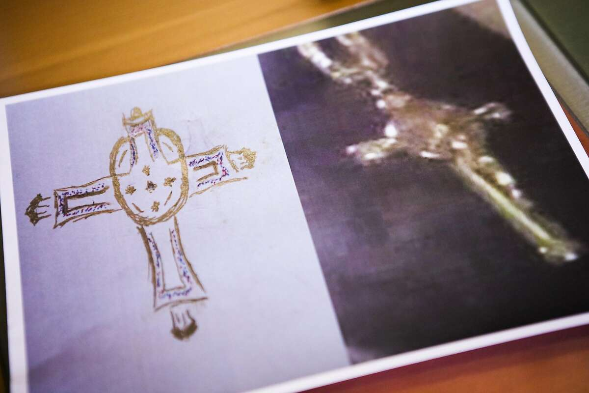 A handout photo depicts a drawing of a gold cross (at left) that police allegedly gave to a witness of the Stanislav Petrov beating, as well as a photograph (at right) of a cross that Petrov alleges was stolen from him by police, during a press conference where Petrov's lawyers announced that they plan to file a federal civil rights lawsuit, in Oakland, California, on Tuesday, March 29, 2016.