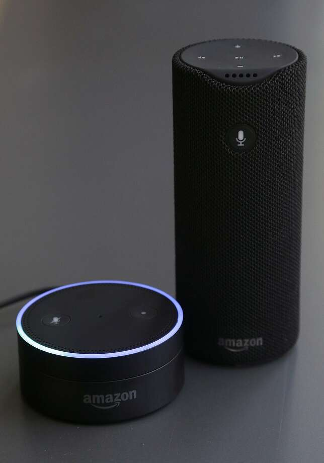 This Wednesday, March 2, 2016 photo shows an Echo Dot, left, and an Amazon Tap in San Francisco. Amazon.com is introducing two devices, the Amazon Tap and Echo Dot, that are designed to amplify the role that its voice-controlled assistant Alexa plays in people's homes and lives. (AP Photo/Jeff Chiu) Photo: Jeff Chiu, AP