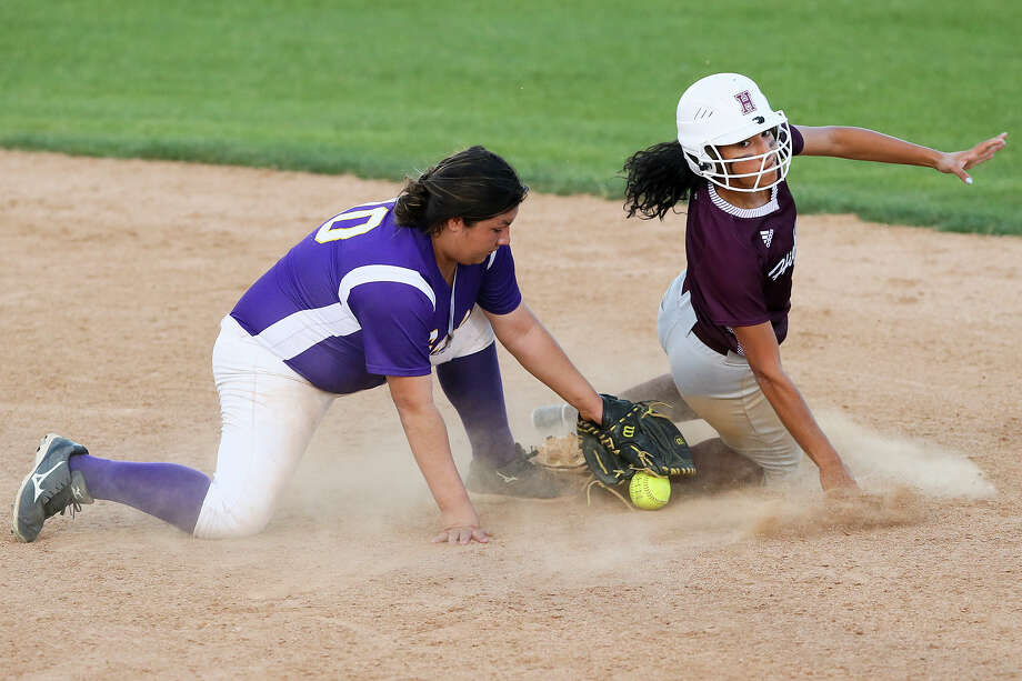 Highlands' Jenelle Rodriguez (right) slides safely into second as Brackenridge's Cecilia Camacho tries to control the ball during a March 22 game at Mary Ann Villarreal Sports Complex. Photo: Marvin Pfeiffer /San Antonio Express-News / Express-News 2016
