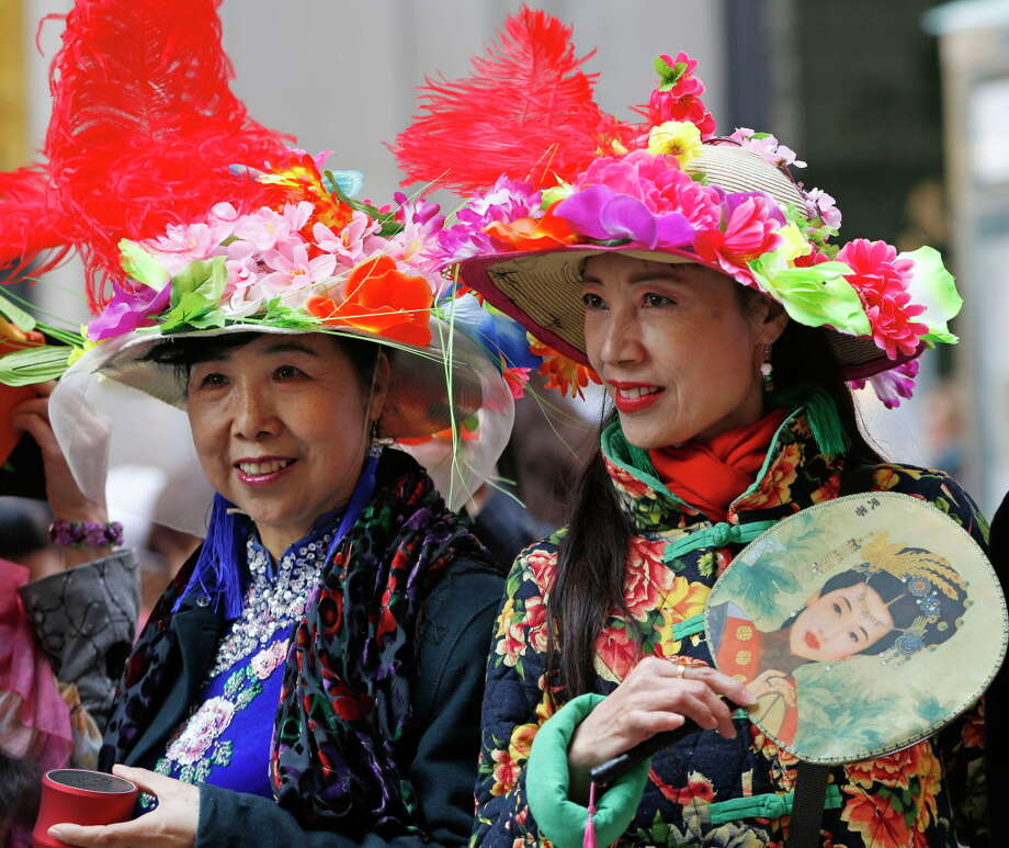 Two women who were part of a Chinese designer's fashion shoot pause between photographs during the annual Easter parade along Fifth Avenue near St. Patrick's Cathedral, Sunday, March 27, 2016, in New York. (AP Photo/Kathy Willens) ORG XMIT: NYKW108 Photo: Kathy Willens, AP / Copyright 2016 The Associated Press. All rights reserved. This m
