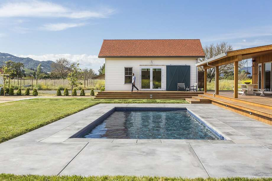 """You can run a few steps out of the bedrooms and jump in the pool,"" says Carlson. The deck serves as a second living room overlooking the Sonoma landscape. Photo: Laure Joliet / Special To The Chronicle"