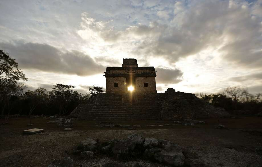 The sun shines directly through the door of the Seven Dolls Temple in the Maya Ruins of Dzibilchaltun, in the Mexican state of Yucatan, as it rises on the spring equinox on March 21. Photo: ALEJANDRO MEDINA, AFP/Getty Images