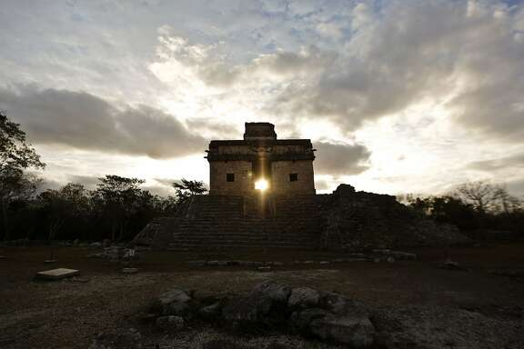 TOPSHOT - The sun shines directly through the door of the Seven Dolls Temple in the Maya Ruins of Dzibilchaltun, in the Mexican state of Yucatan, as it rises on the spring equinox on March 21, 2016. AFP PHOTO/ALEJANDRO MEDINA / AFP PHOTO / ALEJANDRO MEDINAALEJANDRO MEDINA/AFP/Getty Images