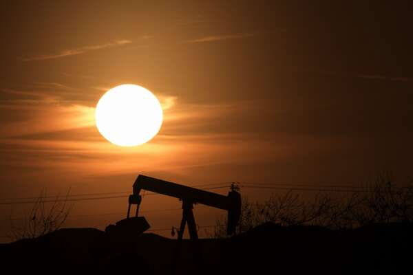 EDMOND, OK - FEBRUARY 20: The sun sets behind an old oil well February 20, 2016 in Edmond, Oklahoma. The state is now the earthquake capital of the world and the quakes are believed to be caused by oil field waste water injections into the earth. In 1993, the Oklahoma Energy Resources Board began to restore abandoned oil well sites. Since the program's inception more than $90 million has been spent to restore more than 14,500 abandoned well sites. Officials report the old wells have leaked oil, natural gas and brine into the soil. (Photo by J Pat Carter/Getty Images)