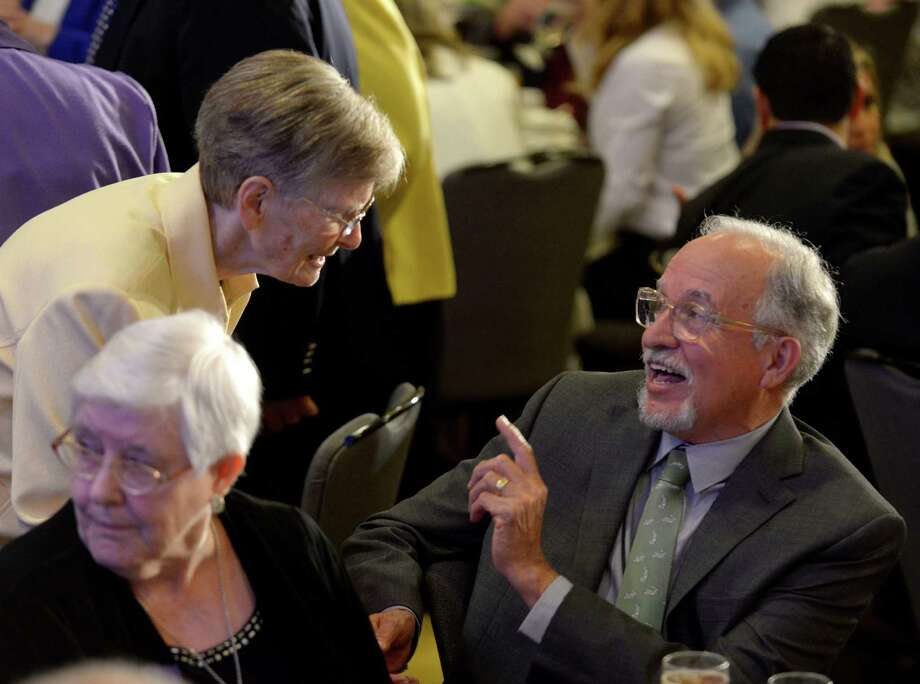 Sister Ann Petru  speaks with Joe Valadez during a luncheon at the Hyatt Regency hotel to celebrate the 150th anniversary of the Sisters of Divine Providence in Texas.  Sister Superior St. Andrew Feltin and Sister Marie Alphonse Boegler were the first two members in the Lone Star State, landing at Galveston in 1866. In San Antonio, the organization runs Our Lady of the Lake University and Providence High School. Photo: Billy Calzada / San Antonio Express-News / San Antonio Express-News