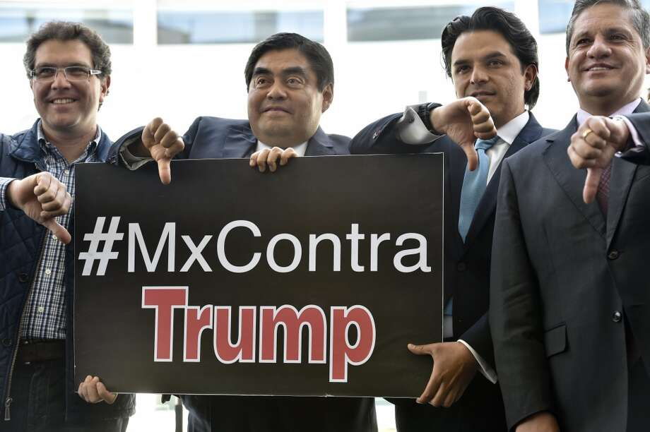 Click through this slideshow to see Mexico's Trump hate.Mexican Senators of left-wing Party of the Democratic Revolution (PRD) hold a sign with a hashtag against US Republican presidential candidate Donald Trump as they give their thumbs down in Mexico City on March 29, 2016.     AFP PHOTO/ Yuri CORTEZ / AFP / YURI CORTEZ Photo: AFP/Getty Images