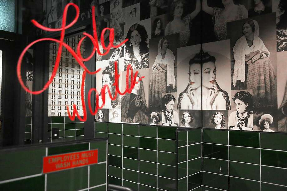 Designer Jay Jeffers was inspired in his design for new Mission District bar Wildhawk by femme fatale Lola Montez, the woman in the custom collage wallpaper in the bar's powder room. Photo: Liz Hafalia, The Chronicle