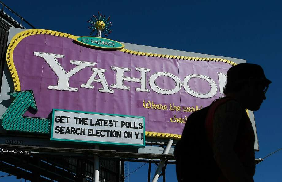 For a while, Yahoo was the place where the world checked in daily, as the bright billboard on eastbound  Interstate-80 at 6th Street reminded drivers. But as dot-com exuberance faded, so did Yahoo, and the company dropped the sign in 2011 after a 12-year run. Photo: Justin Sullivan, Getty Images
