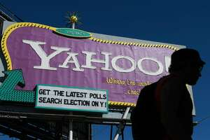 SAN FRANCISCO - OCTOBER 21:  A pedestrian walks by a Yahoo billboard October 21, 2008 in San Francisco, California. Yahoo announced today that it will cut at least 1,400 jobs from from its workforce after reporting dismal third quarter earnings. Yahoo reported a 64 percent drop in earnings to $54.3 million, or 4 cents per share comapred to $151.3 million, or 11 cents per share one year ago. (Photo by Justin Sullivan/Getty Images)